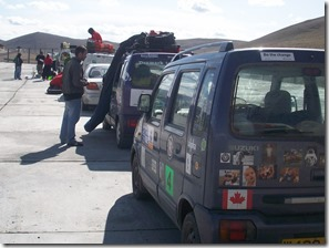 Line of Mongol Rally vehicles waiting for paperwork to clear